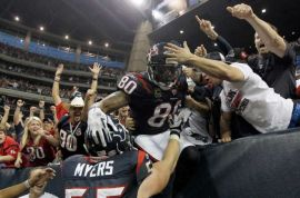 Andre Johnson celebrates his first playoff touchdown (Houston Chronicle)